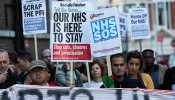 Protestors demonstrate against East London NHS cuts outside the London Hospital
