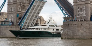 Superyacht Sea Owl parades under Tower Bridge