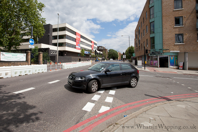 Fixed barriers on the Highway force traffic out of Wapping Lane to turn left