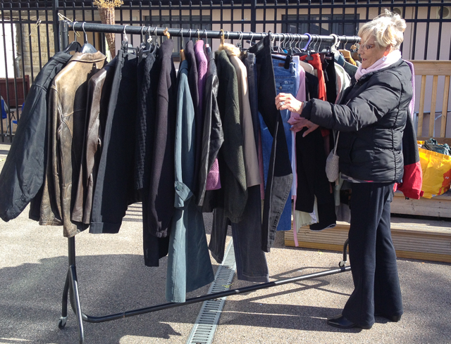 Image of browsing clothes rails at St Mary and St Michael Primary School boot sale