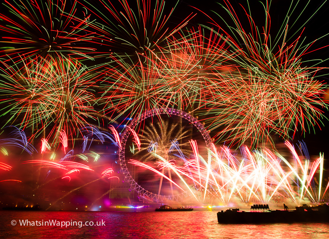 Multi-coloured fireworks explode at the London Eye on the River Thames